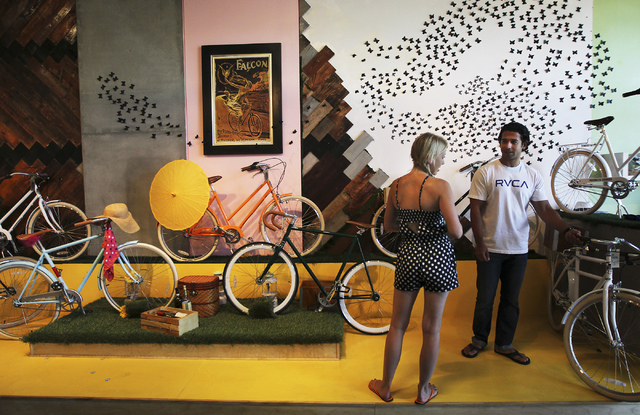 Owner Amie Pellegrini, left, talks with potential customer and neighbor Mike Foskaris in her newly opened shop The Town Bike at the Juhl condo building in Las Vegas on Sept. 17, 2013. (Jason Bean/ ...