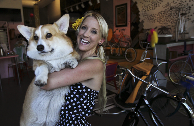 Owner Amie Pellegrini poses for a portrait with her dog Steve in her newly opened shop The Town Bike at the Juhl condo building in Las Vegas on Sept. 17, 2013. (Jason Bean/Las Vegas Review-Journal)