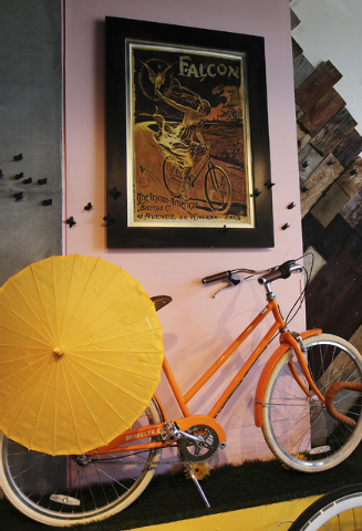 Artwork featuring women on bikes adorn the walls of Amie Pellegrini's newly opened shop The Town Bike at the Juhl condo building in Las Vegas on Sept. 17, 2013. (Jason Bean/Las Vegas Review-Journal)