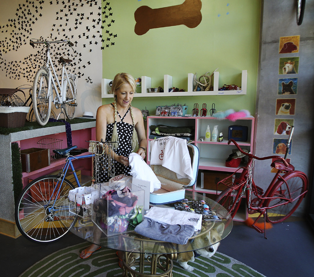 Owner Amie Pellegrini works on a display in her newly opened shop The Town Bike at the Juhl condo building in Las Vegas on Sept. 17, 2013. (Jason Bean/Las Vegas Review-Journal)
