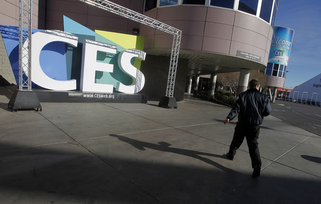A security guard enters the Las Vegas Convention Center for the Consumer Electronics Show in this file photo. (AP Photo/Isaac Brekken)