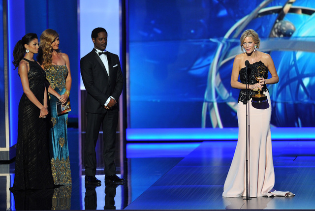 """Anna Gunn, right, accepts the award for outstanding supporting actress in a drama series for her role on """"Breaking Bad"""" at the 65th Primetime Emmy Awards at Nokia Theatre on Sunday in Los Angeles. ..."""