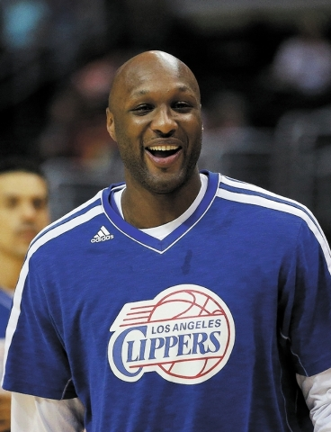 FILE - In this March 13, 2013, file photo, Los Angeles Clippers' Lamar Odom smiles during NBA basketball practice in Los Angeles.  Odom has been charged Friday, Sept. 13, 2013, with a misdemeanour ...
