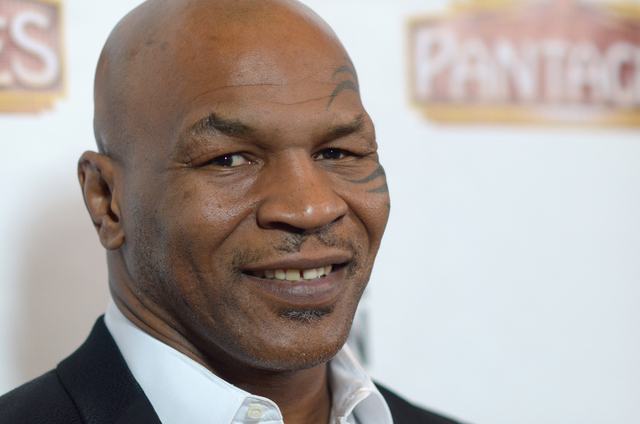 "Mike Tyson arrives at the LA premiere of ""Mike Tyson: Undisputed Truth"" in March. (Photo by Richard Shotwell/Invision/AP)"