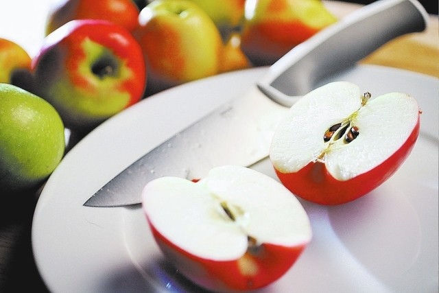 Apples are photographed in the Review-Journal studio Thursday, Sep. 5, 2013. (Photo illustration by Jessica Ebelhar/Las Vegas Review-Journal)  (NOTE: apple shown in the front here is #8; Heidi has ...