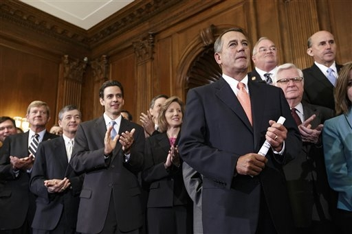 Speaker of the House John Boehner, R-Ohio, right, is cheered as Republican members of the House of Representatives rally after passing a bill that would prevent a government shutdown while crippli ...