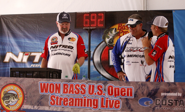 Professional angler Matt Massey, of Golden, Colo., center,  is interviewed by Western Outdoor News Director of Operations Billy Egan, right, after having his catch weighed by Weigh Master Bill Coo ...