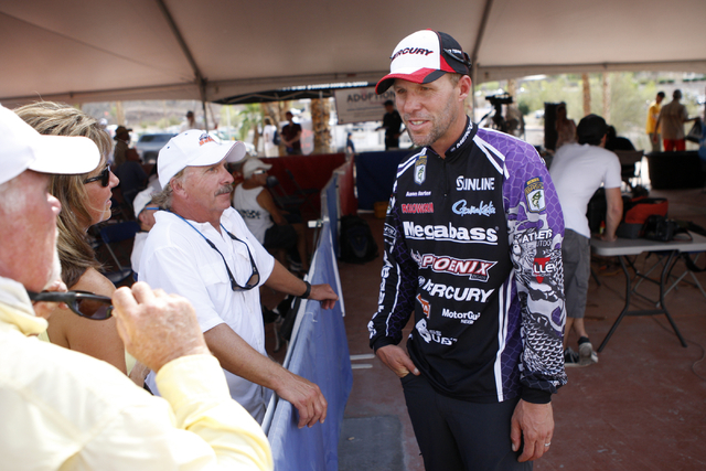 Professional angler Aaron Martens, of Leeds, Ala., talks to fans after having his catch weighed at Callville Bay Marina on Lake Mead during the NITRO Mercury WON Bass U.S. Open bass fishing tourna ...