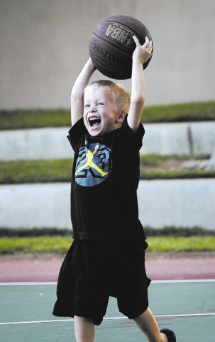 Hayden Christiansen plays basketball with his family at The Willows Park, Aug. 28. (Jason Bean/View)