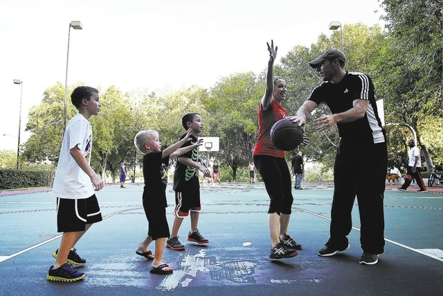 Robert Christiansen, far right, and his wife, Sue, play basketball with their children, from left, Dane, Hayden and Cade, at The Willows Park, Aug. 28. (Jason Bean/View)