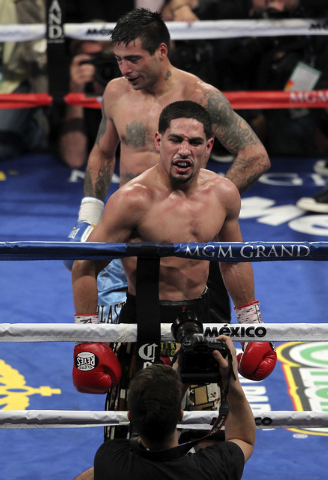 Danny Garcia, front, celebrates his victory over Lucas Matthysses for the WBC and WBA Super Lightweight titles at the MGM Grand Garden Arena in Las Vegas on Sept. 14, 2013. (Jason Bean/Las Vegas R ...