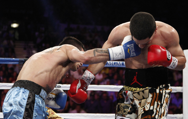 Lucas Matthysses hits Danny Garcia during their WBC and WBA super lightweight title bout at the MGM Grand in Las Vegas Saturday, Sept. 14, 2013. (John Locher/Las Vegas Review-Journal)