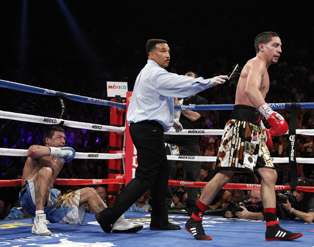 Danny Garcia walks away after knocking Lucas Matthysses down in the 11th round of their WBC and WBA super lightweight title bout at the MGM Grand in Las Vegas Saturday, Sept. 14, 2013. (John Loche ...