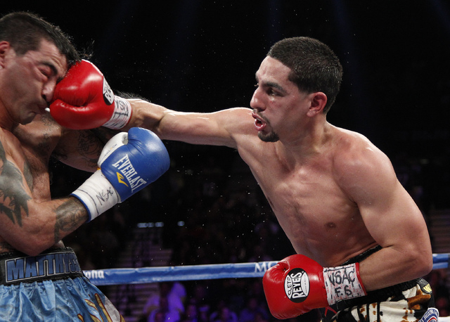 Danny Garcia hits Lucas Matthysses during their WBC and WBA super lightweight title bout at the MGM Grand in Las Vegas Saturday, Sept. 14, 2013. (John Locher/Las Vegas Review-Journal)