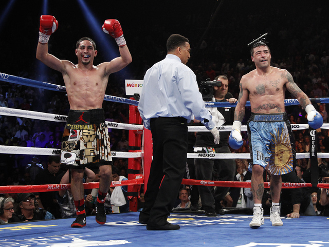 Danny Garcia celebrates after beating Lucas Matthysses to retain the WBC and WBA super lightweight title bout at the MGM Grand in Las Vegas Saturday, Sept. 14, 2013. (John Locher/Las Vegas Review- ...