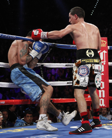 Danny Garcia knocks down Lucas Matthysses  in the 11th round of their WBC and WBA super lightweight title bout at the MGM Grand in Las Vegas Saturday, Sept. 14, 2013. (John Locher/Las Vegas Review ...