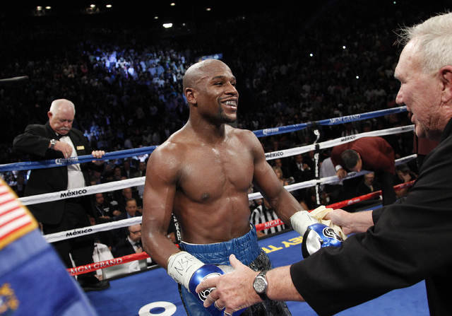 Floyd Mayweather celebrates after defeating Canelo Alvarez in their WBC and WBA super welterweight title bout at the MGM Grand in Las Vegas Saturday, Sept. 14, 2013. (John Locher/Las Vegas Review- ...