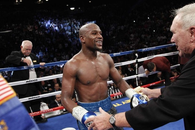 Floyd Mayweather celebrates after defeating Canelo Alvarez in their WBC and WBA super welterweight title bout at the MGM Grand in Las Vegas Saturday, Sept. 14, 2013. Veteran Las Vegas boxing judge ...