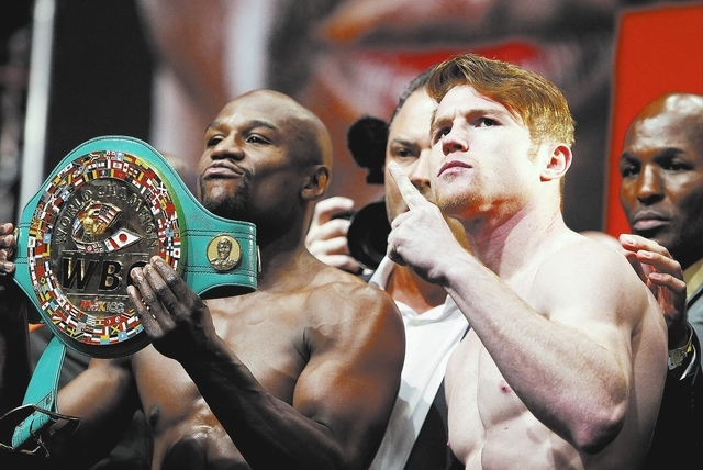 Canelo Alvarez, right, and Floyd Mayweather pose during a weigh in at the MGM Grand in Las Vegas Friday, Sept. 13, 2013. The two will fight Saturday in a title bout at the MGM Grand.(John Locher/L ...