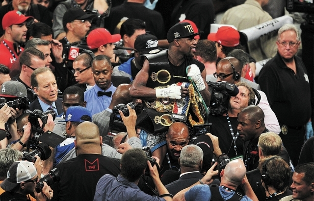 Floyd Mayweather celebrates his majority decision victory over Canelo Alvarez for the WBC and the WBA Super Welterweight titles at the MGM Grand Garden Arena in Las Vegas on Sept. 14, 2013. (Jason ...