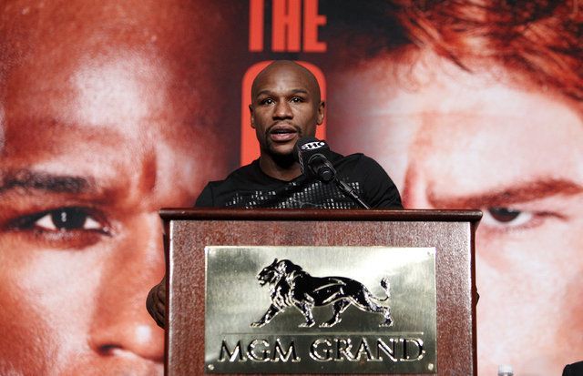 Floyd Mayweather speaks during a press conference in Las Vegas Wednesday, Sept. 11, 2013. Mayweather  will fight Canelo Alvarez in a WBC/WBA 154 pound title fight at the MGM Grand in Las Vegas on  ...