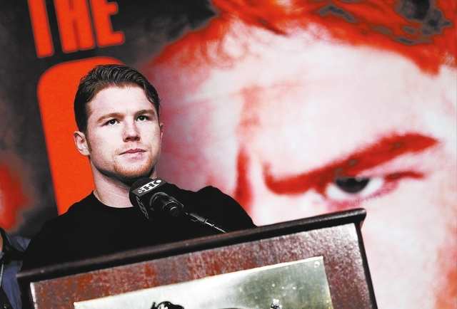 Canelo Alvarez speaks during a press conference in Las Vegas Wednesday, Sept. 11, 2013. Alvarez will fight Floyd Mayweather, in a WBC/WBA 154 pound title fight at the MGM Grand in Las Vegas on Sat ...
