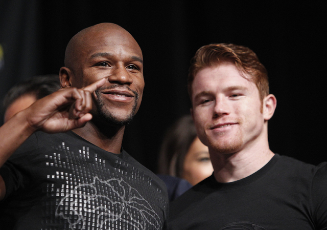 Floyd Mayweather, left, and Canelo Alvarez pose during a press conference in Las Vegas Wednesday, Sept. 11, 2013. The two will fight in a WBC/WBA 154 pound title fight at the MGM Grand in Las Vega ...