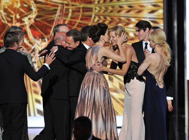 """The cast and crew of """"Breaking Bad"""" accept the award for outstanding drama series at the 65th Primetime Emmy Awards on Sunday.  (Vince Bucci/Invision for Academy of Television Arts & Sciences/AP I ..."""