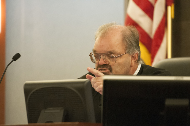 Judge Conrad Hafen is seen addressing David Allen Brutsche in the courtroom for his preliminary hearing at the Regional Justice Center, Thursday, Sept. 26, 2013, in Las Vegas, Nev. Brutsche faces  ...
