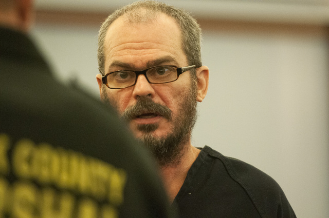 David Allen Brutsche stands in the courtroom for his preliminary hearing at the Regional Justice Center, Thursday, Sept. 26, 2013, in Las Vegas, Nev. Brutsche faces charges for conspiracy to commi ...