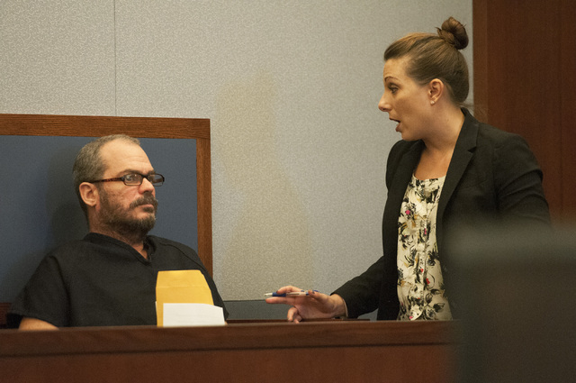 David Allen Brutsche, left, is seen in the courtroom for his preliminary hearing at the Regional Justice Center, Thursday, Sept. 26, 2013, in Las Vegas, Nev. Brutsche faces charges for conspiracy  ...