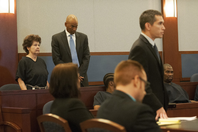 Devon Campbell Newman, left, stands in the courtroom for her preliminary hearing at the Regional Justice Center, Thursday, Sept. 26, 2013, in Las Vegas, Nev. Newman faces charges for conspiracy to ...
