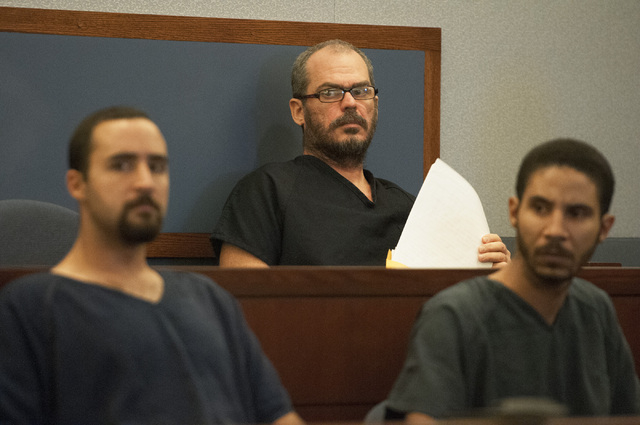David Allen Brutsche, center, is seen in the courtroom for his preliminary hearing at the Regional Justice Center, Thursday, Sept. 26, 2013, in Las Vegas, Nev. Brutsche faces charges for conspirac ...