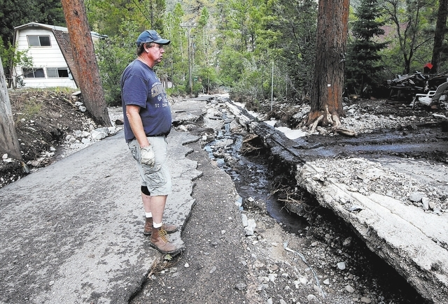 Justin Yurkanin/Las Vegas Review-Journal Dennis Lovell a resident of Kyle Canyon walks near the top of Rainbow Canyon Blvd. in the Rainbow Canyon subdivision in Kyle Canyon on Monday Sept. 2, 2013 ...