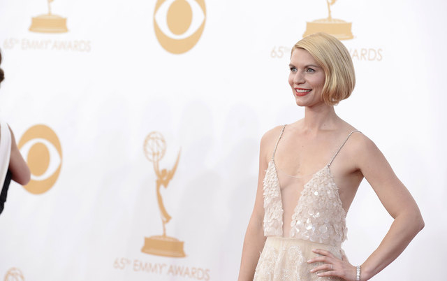 """Claire Danes won the award for best actress in a drama series for her role in """"Homeland"""" at the 65th Primetime Emmy Awards on Sunday in Los Angeles.  (Photo by Dan Steinberg/Invision/AP)"""