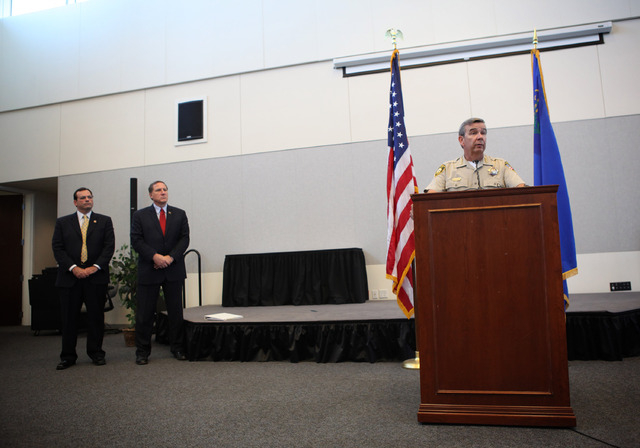 Clark County Sheriff Doug Gillespie, right, speaks at a press conference discussing a six-month Department of Justice review of the Las Vegas Metropolitan Police Department's use of force policies ...