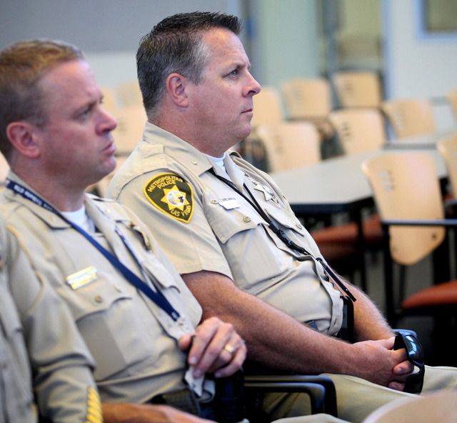 Todd R. Fasulo, deputy chief with Metro, right, listens during a Department of Justice review of the Las Vegas Metropolitan Police Department's use of force policies and practices at a press confe ...