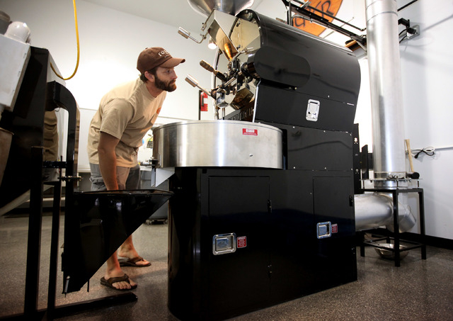 Erik Anderson, owner of Colorado River Coffee Roasters, checks on coffee beans while roasting them at the Boulder City, Nev., business Thursday, Sep. 12, 2013. (Jessica Ebelhar/Las Vegas Review-Jo ...