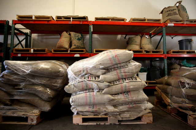 Pallets of coffee from different countries are seen at Colorado River Coffee Roasters in Boulder City, Nev., Thursday, Sep. 12, 2013. (Jessica Ebelhar/Las Vegas Review-Journal)