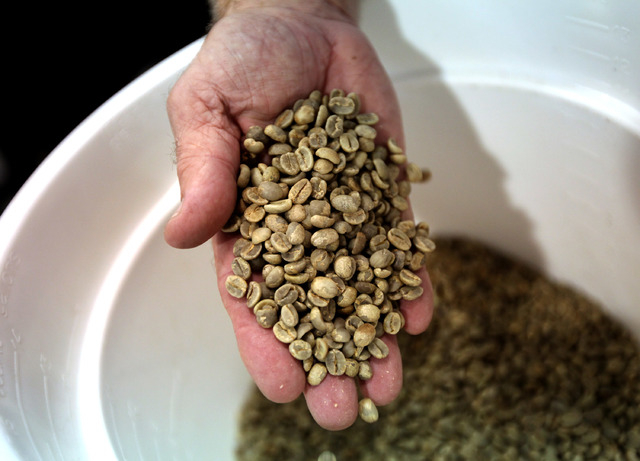 Coffee beans from Colombia, Ethiopia, and Brazil are seen before they are roasted at Colorado River Coffee Roasters in Boulder City, Nev., Thursday, Sep. 12, 2013. (Jessica Ebelhar/Las Vegas Revie ...