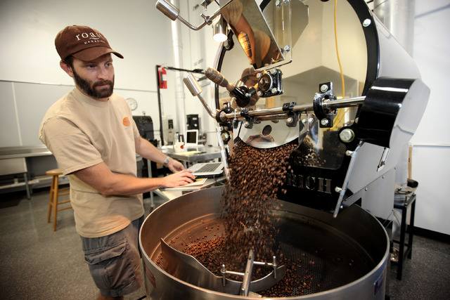 Erik Anderson, owner of Colorado River Coffee Roasters, releases coffee beans to cool them after they were roasted them at the Boulder City, Nev., business Thursday, Sep. 12, 2013. (Jessica Ebelha ...