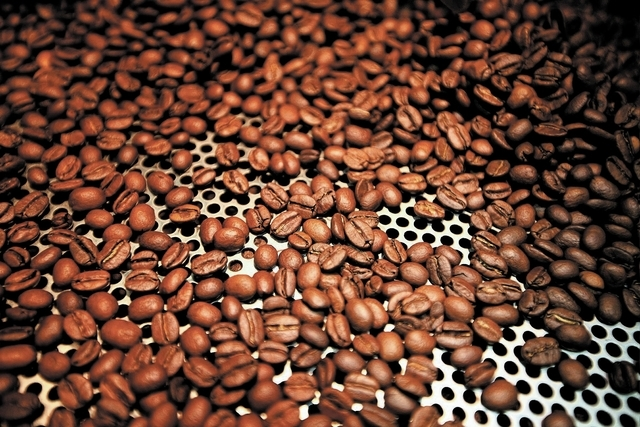 Coffee beans from Colombia, Ethiopia, and Brazil are seen after they were roasted at Colorado River Coffee Roasters in Boulder City, Nev., Thursday, Sep. 12, 2013. (Jessica Ebelhar/Las Vegas Revie ...
