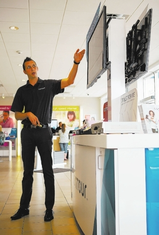 Jonathan Brooks, Senior Marketing Manager for Cox Communications, demonstrates the new Contour television service Thursday, Sept. 12, 2013 at the 9240 W. Sahara Avenue Cox Solutions Store. The ser ...