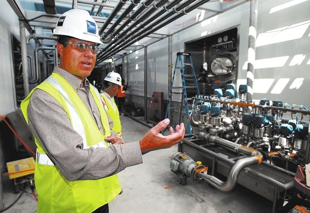 Facility Manager Wesley Clark talks about the $85 million Dairy Farmers of America's milk production plant under construction in Fallon, Nev., on Thursday, Sept. 19, 2013. State-of-the-art technol ...