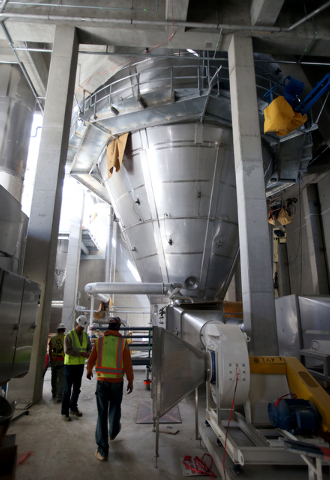 Crews work on the $85 million Dairy Farmers of America milk production plant under construction in Fallon, Nev., on Thursday, Sept. 19, 2013. The evaporator, at center, will process 2 million poun ...