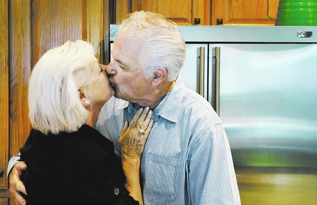 Harvey Levy kisses his wife Jane in the kitchen of their home near Eastern Avenue and Reunion Drive in Henderson on Monday, Aug. 26, 2013. Harvey, who has Alzheimer's disease, recently participate ...