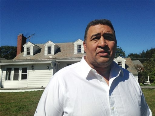 Former NFL offensive lineman Brian Holloway stands in front of his rural vacation home Wednesday, Sept. 18, 2013, in Stephentown, N.Y. Holloways rural vacation home was trashed during a Labor Day  ...