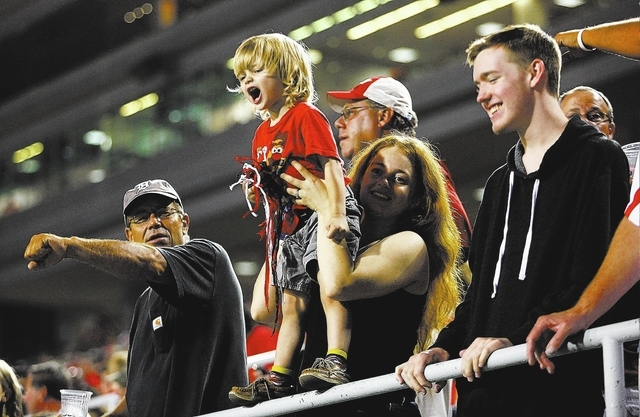 UNLV fans cheer as the team plays against Central Michigan at Sam Boyd Stadium in Las Vegas on Saturday, Sept. 14, 2013. (AP Photo/Las Vegas Review-Journal, Chase Stevens)