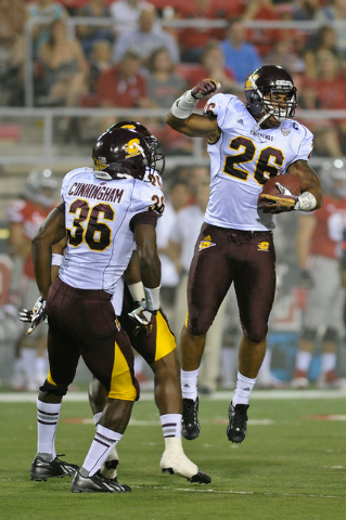 Central Michigan linebacker Shamari Benton (26) celebrates with Avery Cunningham (36) after intercepting a Nick Sherry pass during a football game against UNLV at Sam Boyd Stadium in Las Vegas Sat ...