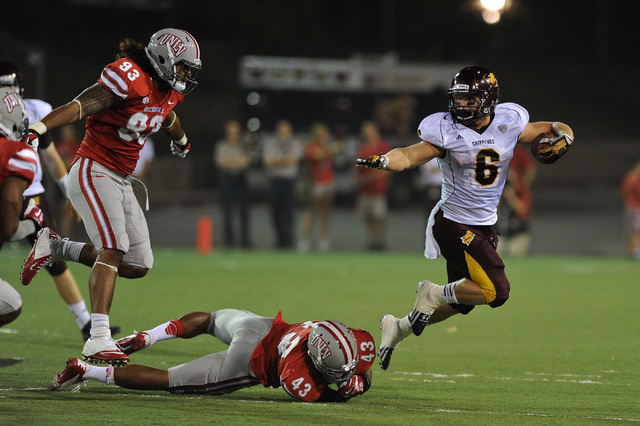 Central Michigan running back Saylor Lavallii (6) breaks free from UNLV's Sonny Sanitoa (93) and Tim Hasson (43) during a football game at Sam Boyd Stadium in Las Vegas Saturday, Sept. 14, 2013. ( ...